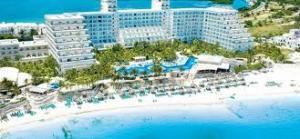 Photo from http://www.signaturevacations.com/Cancun/Hotels/Riu-Caribe.aspA picture of the Riu Caribe hotel in Cancun