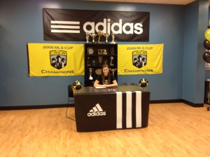 Photo by: Julie DelucaAmelia signed in Grand Rapids along with 36 other crew juniors. She signed with her travel club instead of signing at Loy Norrix.