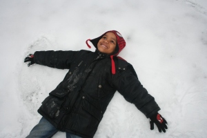 Antrell Jr. makes a snow angel in his grandmas backyard. He enjoys winter time.