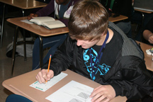 Photo by Jay McintoshJunior Brian Bartley focused full attention to his Economics final exam.  Bartley relies on his good memory skills to pass classroom tests.