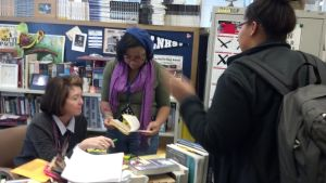 Anne Lewis discusses an assignment with two senior students from her College English class. Amyre and Nikita enjoy the time Lewis provides to answers their questions.
