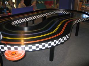 photo by Ronniqua Phillips The Slot Car Race Track involves you to build a race car to experiment in the electricity being used to make its way around the track, here in the Science Exhibit.