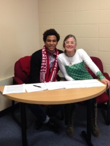 Mcintosh celebrates with mother Melinda on signing day.