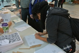 Students fill out information sheets and pick up their complimentary information packets for the day.