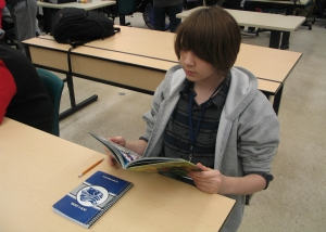 "Freshman Bela Coats focused on reading the comic book ""Kingdom Come,"" written by Mark Waid and art by Alex Ross. Coats says he's been reading ""Kingdom Come"" for a couple of days. Photo Credit / Kyron Williams"