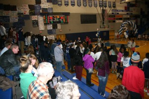 Loy Norrix basketball fans support the team and Winterfest Court. Half time score read 33-20, Marian ahead.
