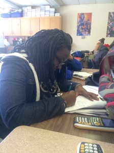 During 5th hour, junior Sarah Giramia focuses on her Algebra 2 study guide. She will be taking this exam on Thursday.