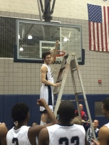 Spencer Welsh cutting the net down