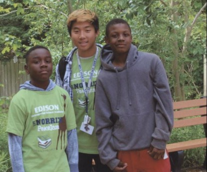 Chhay Wong with Joshua Williams-Thomas and Johari Brashers, two students from Edison Elementary, at Binder Park Zoo attending the PeaceJam field trip.