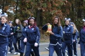Loy Norrix cheerleaders marching and enjoying some Hot Cheetos.