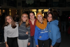 Group of friends hanging out at the homecoming dance.