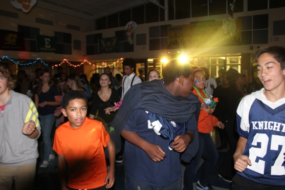 Group of friends groovin to the Cupid shuffle.