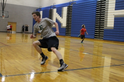 Senior Grant Mitchell runs during this seasons basketball tryouts. This year's tryouts are even more competitive due to past success. Photo Credit: Paul Vallier
