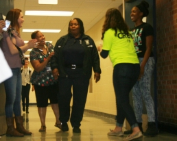 Hampton walks in to the cafeteria to the hundred of kids cheering for her. Photo Credit / Audra Penny