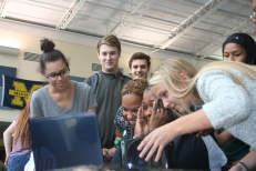 A couple of students gather around Hampton to watch her appreciation video with her. The video was created by a few Link Crew leaders who planned the project. Photo Credit / Audra Penny