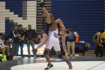 A Loy Norrix wrestler takes down a Portage Central wrestler in a match last year. The knights look to improve upon their season from last year. Photo Credit: Yearbook