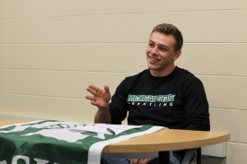 Nick May is ecstatic after signing with the Big 10 school, Michigan State University. He signed to wrestle for the university on November 19th, 2015. Photo Credit / Chris Hybels