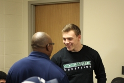 May is congratulated by Loy Norrix security staff. He has been a four year varsity wrestler, and three year varsity football player. Photo Credit / Chris Hybels
