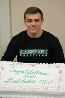 May poses with his custom celebratory Michigan State cake. His family and friends were in attendance for his signing party. Photo Credit / Chris Hybels