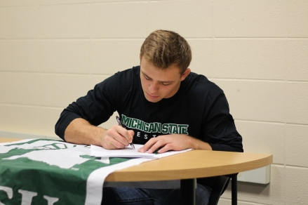 May signing the papers for a four year commitment to Michigan State. May was the Michigan state runner-up last year in his weight class, last season. Photo Credit / Chris Hybels