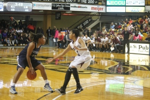 Senior Aviance Alexander-Brown crosses over a Kalamazoo Central player in last year's game. The Giants went on to win 79-51.Photo Credit: Yearbook