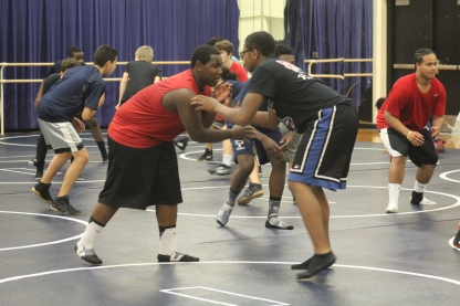 Wrestlers prepare for the season to begin. Wrestling is a no cut sport, but it takes a lot of dedication and hard work. Photo Credit: Paul Vallier