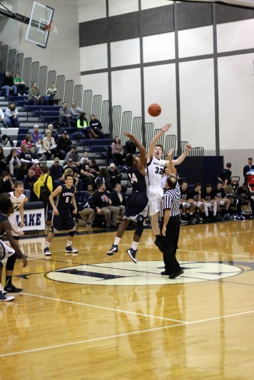 Senior DQ Hunter goes up for the ball during tip-off. From the tip-off to the final buzzer the Knights were in control of the game. Photo Credit / Chris Hybels
