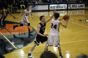 Senior Grant Mitchell defends a Gull Lake player. The Knights were able to keep the Blue Devils to only a mere 25 points total. Photo Credit / Chris Hybels