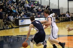 Senior Grant Mitchell drives by a Gull Lake defender. Mitchell was named one of the top basketball players in the Kalamazoo area by MLIve. Photo Credit / Chris Hybels