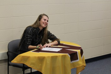 Jane Labadie signs her four year commitment to Western Michigan. She has played varsity soccer for the Knights since freshman year. Photo Credit / Chris Hybels