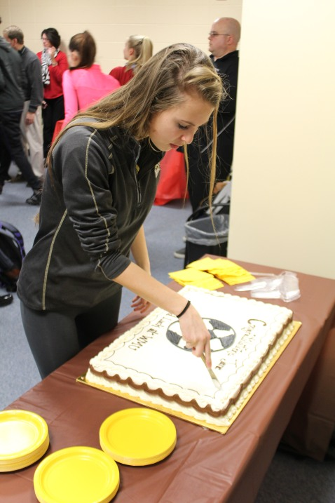 Jane Labadie cuts into her chocolate Western Michigan University cake. She plans to play for the Broncos in the spring of 2017. Photo Credit / Chris Hybels