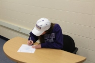 Marah Ranger signs her commitment to Albion College to be a play with their lacrosse team. For the past 4 years, Ranger has been a part of the Kalamazoo Women's United lacrosse team. Photo Credit / Caitlin Commissaris