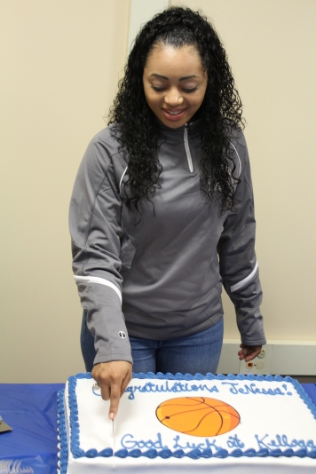 JaNessa Boggan cuts into her Kellogg Community College Cake. In the winter season of 2017, Boggan plans to be a part of their Women's Basketball team. Photo Credit / Caitlin Commassaris