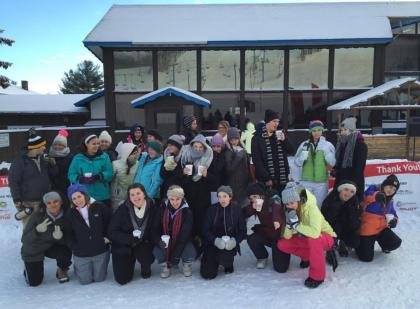 All the volunteers pose for a group photo in front of the Timber Ridge lodge. Volunteers are all part of the health science EFE. Photo credit / Kathy Nyberg