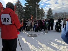 The torch is lit to signify the start of the games. Around 1,000 volunteers, athletes and sponsors came to the games. Photo credit / Reace Hammel