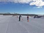 Athletes complete their course in the cross country skiing event. The events included snowboarding, alpine skiing, snow shoeing, and cross country skiing. Photo credit / Reace Hammel