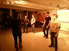 Carmack instructs a group of male dancers on their sequence.