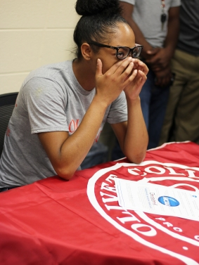 Maia Greer wipes the tears from under her eyes as her coach gives an inspirational speech about Greer's growth both as a person and athlete. She will be playing softball for Olivet next year. Photo Credit / Caitlin Commissaris