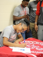 Maia Greer signs to Olivet College. She smiles brightly thinking about what's to come. Photo Credit / Caitlin Commissaris