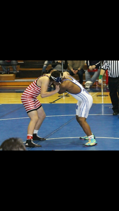 Jalen Pace wrestling to be the conference champion. Photo credit / Marelyn Krueger