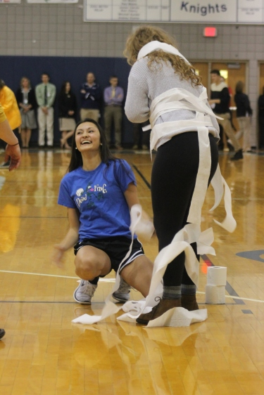 Junior Lizzie Ko tries her best to wrap Junior Maileen Bugnaski with toilet paper. They wanted to beat the seniors to make the class of 2017 proud.