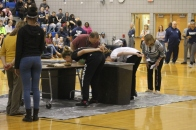 """Sophomore Jazman Davenport holds her hands behind her back while she is eating apple pie as fast as she can in one of the games at the Pep Rally. """"I felt like I could win, but the pie was just so dry,"""" said Davenport."""