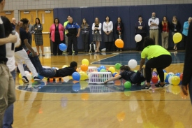 "Juniors Lauren Cole and Ashantai Hale-Sandifer compete during the balloon game at the Spring Pep Rally. ""This game made me so dizzy, but I had a lot of fun though,"" said Cole."