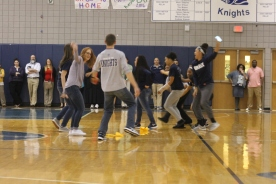 "Teachers Paige O'Shea, Jennifer Watson and Tim Geerlings dance with some students in front of everyone at the Spring Pep Rally. ""I was nervous but I felt the support from the students and once I felt that, I knew I could to everything,"" said O'Shea."