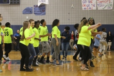 """Junior Sacha Williams dances with Link Crew during the Running Man challenge that ended the Spring Pep Rally. """"We just thought it would be fun to do a flash mob and surprise people,"""" said Williams."""