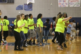 "Junior Sacha Williams dances with Link Crew during the Running Man challenge that ended the Spring Pep Rally. ""We just thought it would be fun to do a flash mob and surprise people,"" said Williams."