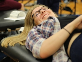 Senior Audrey Lyons is experienced in donating her blood. Even though she is experienced she still likes someone to talk to while donating. Photo Credit / Jonathan Lo