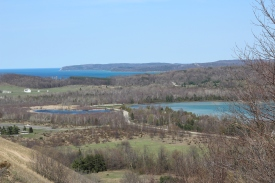 At the top of Sleeping Bear Dunes. This overlooks Glen Lake to the right and Lake Michigan in the far back. Photo Credit / Clayton Barker