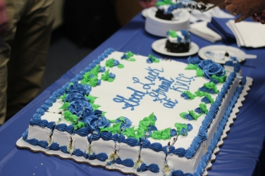 For commitments athletes celebrate with cake designed in the future school colors of the athletes. Here is Grant Mitchell's cake being cut to share among the family and friends. Photo Credit / Paul Vallier