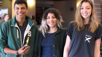 Seniors Jordan Brown, Cindy Bravo and junior Nora Hilgart-Griff celebrate Knight Life's Student Choice Award. Knight Life won first place in the Front Page category of the Student Choice Awards. Photo Credit / Christian Baker